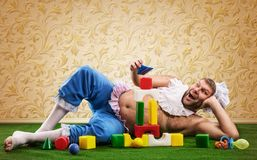 Happy man weared as baby Royalty Free Stock Image