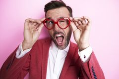 Happy man wearing funny glasses Stock Photos