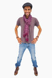 Happy man wearing peaked cap and scarf looking at camera Royalty Free Stock Photography
