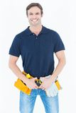 Happy man wearing tool belt Stock Image