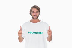 Happy man wearing volunteer tshirt giving thumbs up Stock Photography