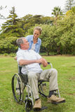 Happy man in wheelchair and daughter talking Stock Image