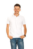 Happy man in white t-shirt. Happy casual man in white blank t-shirt isolated on white background stock images