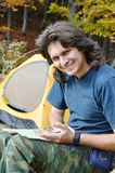 Happy man whith compass in the camp Royalty Free Stock Image