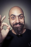 Happy man who says ok with his hand Royalty Free Stock Image