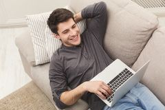 Happy man win. Winner, young man with laptop. Happy excited man celebrate his success. Winner, young man reading on laptop at home, copy space Stock Photos