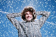 Happy man winter. Portrait of a happy young man with curly hair outdoors Royalty Free Stock Photos