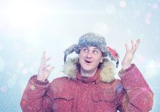 Happy man in winter clothes. Frost, sun, snow, flares Stock Photo