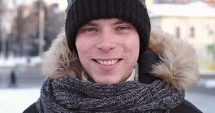 Happy man in winter clothing. Portrait of happy young man in winter clothing stock video