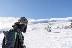 Young Hiker Man in the  Winter Mountain. Happy man in the winter mountain , adventure concept Stock Image