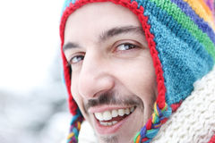 Happy man in winter with wool cap Stock Photography