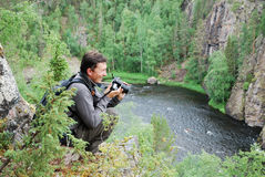 Happy Man With Camera On The Top Of Taiga Forest. Royalty Free Stock Photography