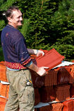Happy Man With Roof Tiles Stock Photos