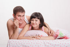 Happy man and woman in bed Royalty Free Stock Photos