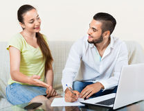 Happy  man and woman with business papers and notebook Royalty Free Stock Images