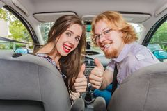 Happy man and woman in car royalty free stock images