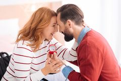 Happy man and woman caressing each other. Lovey dovey. Bearded men proposing to a nice blond women of middle age and she accepting his proposal and they looking Royalty Free Stock Photography