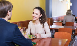 Happy man and woman chatting as having date. Happy men and women chatting as having date in restaurant Stock Photos
