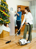 Happy man and woman cleaning Royalty Free Stock Images