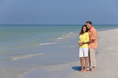 Happy, Man & Woman Couple on An Empty Beach Royalty Free Stock Photos