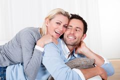Happy man and woman cuddling Stock Photos