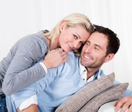 Happy man and woman cuddling Royalty Free Stock Images