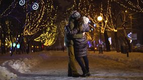 Beautiful couple dance and spin in the falling snow stock video footage
