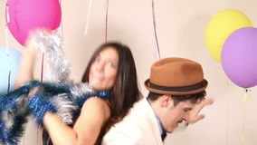 Happy man and woman dancing in party photo booth stock video