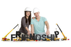 Happy man and woman developing friendship. Royalty Free Stock Images