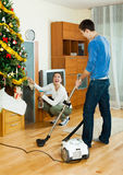 Happy man and woman doing housework Stock Photography
