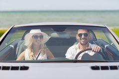 Happy man and woman driving in cabriolet car Stock Photo
