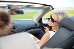 Happy man and woman driving in cabriolet car Royalty Free Stock Image