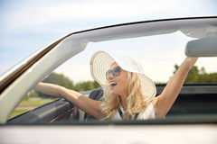 Happy man and woman driving in cabriolet car Stock Photography