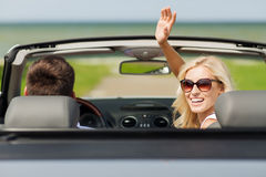 Happy man and woman driving in cabriolet car Royalty Free Stock Photos
