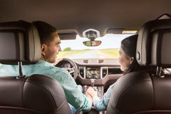 Happy man and woman driving in car Stock Photo