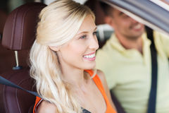 Happy man and woman driving car Stock Photos