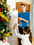 Happy man and woman dusting Stock Photo