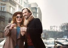 Happy man and woman enjoying coffee on street royalty free stock images