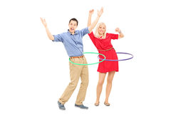 Happy man and woman exercising with hula hoop Stock Image