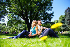 Happy man and woman with flowers. In park Royalty Free Stock Photography