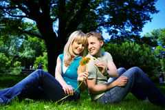 Happy man and woman with flowers Royalty Free Stock Photography