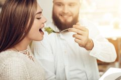 Happy man and woman have lunch in a restaurant stock photos