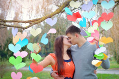 Happy man and woman kissing on Valentine's Day Stock Photos