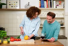 Happy man and woman in the kitchen Stock Photography