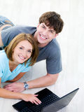 Happy man and woman with laptop Stock Images