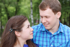Happy man and woman look at each other Stock Image