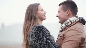 Happy man and woman in love cheerfully laugh, kiss, hug each other. Happy moments with our loved ones. Happy moments with our loved ones. Funny man and woman stock footage