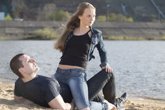 Happy man with woman lying on the beach Stock Photos