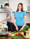 Happy man and the woman make dinner for himself Royalty Free Stock Image