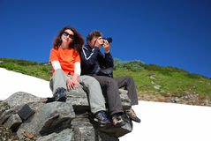 Happy man and woman in mountains Stock Photos